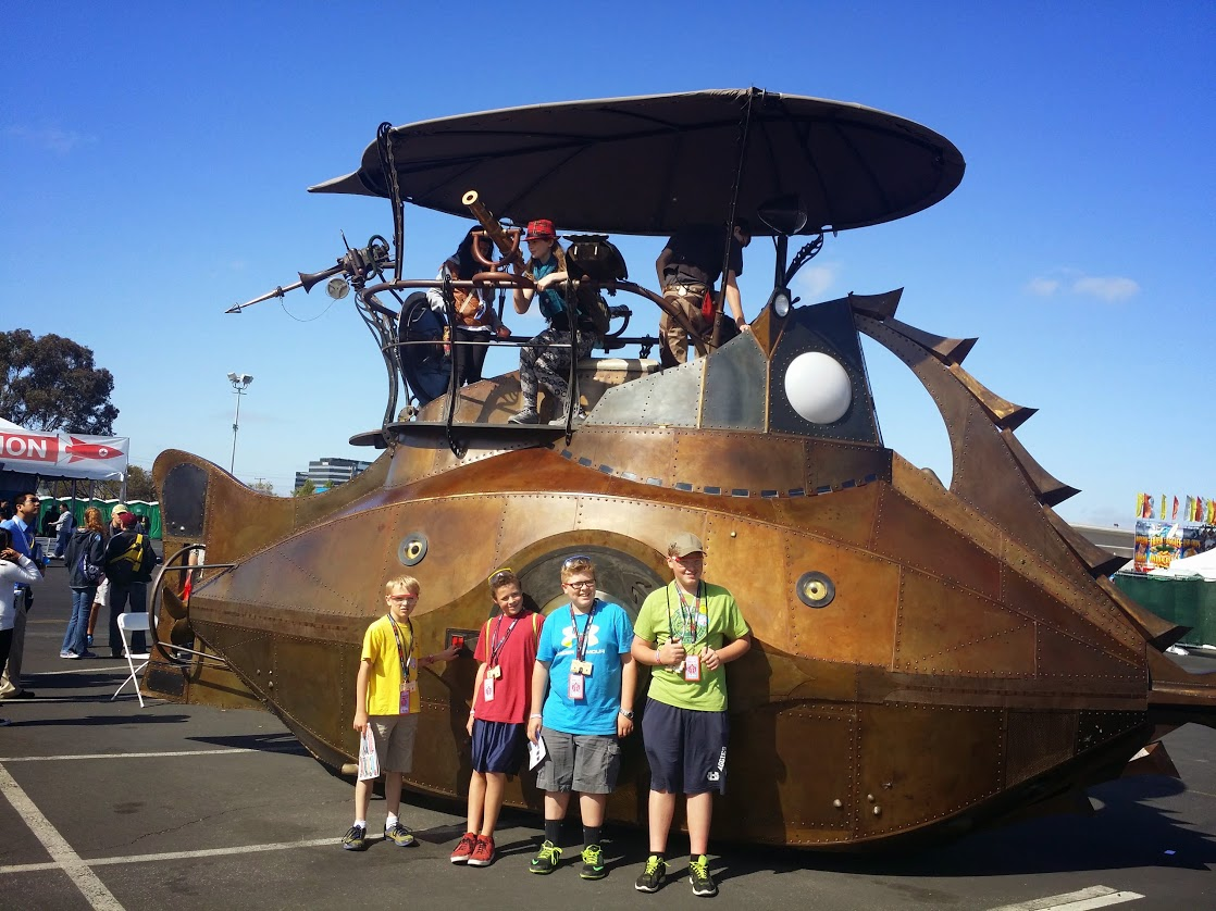4-H youth at Maker Faire standing in front of giant metal submarine.