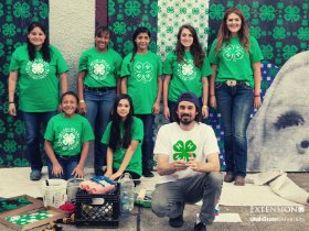 group of teenagers in 4-H branded clothing