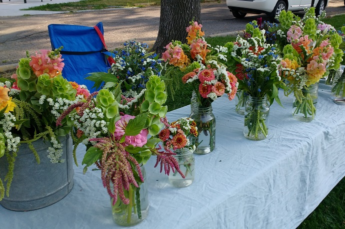 Table with bouquets at farmers market