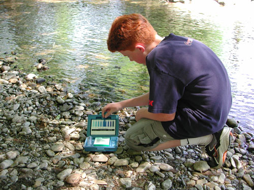 boy comparing dissolved oxygen ampuole to comparator chart